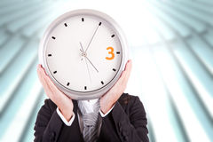 Business woman holding a clock Royalty Free Stock Images