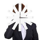 Business woman holding clock Stock Photo