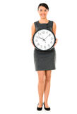Business woman holding a clock Royalty Free Stock Image