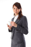 Business woman holding coffee cup Stock Photo