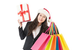Business woman holding colored shopping bags and gift box Stock Photography