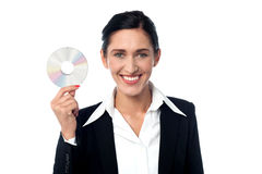 Business woman holding compact disc Stock Images