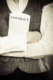 Business woman holding contract in hand Stock Image