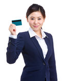 Business woman holding credit card Stock Image
