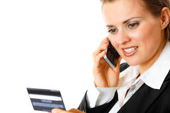 Business woman holding credit card and mobile Stock Image