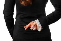 Business woman holding crossed fingers behind back Stock Image