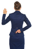 Business woman holding crossed fingers behind back Stock Photos