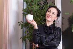 Business woman holding a cup. Stock Image