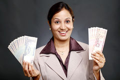 Business woman holding currency notes Stock Images