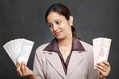 Business woman holding currency notes Stock Image