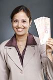 Business woman holding currency notes Royalty Free Stock Photos