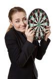 Business woman holding dartboard Stock Photos