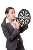 Business woman holding dartboard Stock Image