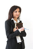 Business woman holding diary in hands Royalty Free Stock Image
