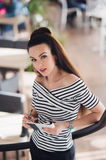 Business woman holding a diary in her hands and looking at the camera. Royalty Free Stock Image