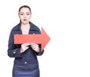 Business Woman Holding Direction Arrow Sign Royalty Free Stock Photography