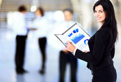 Business woman holding document on clipboard Royalty Free Stock Image