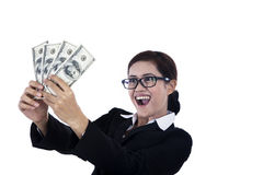 Business woman holding dollars excitedly. A businesswoman is excited because she just made some money Stock Photos