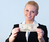 Business woman holding dollars to the camera Stock Image