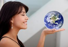 Business woman holding earth Stock Photo