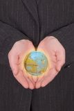 Business woman holding the earth Royalty Free Stock Image