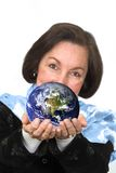Business woman holding earth Royalty Free Stock Photography