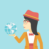 Business woman holding Earth globe. An asian  young business woman holding Earth globe in hand. Concept of global business. Vector flat design illustration Stock Images