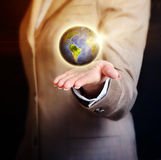 Business woman holding earth globe in her hand Royalty Free Stock Images