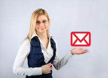 Business woman holding a email message icon Stock Photo