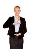 Business woman holding empty copy space between her hands Royalty Free Stock Photography