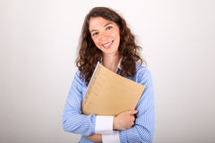 The business woman is holding a file in her hands Stock Photography
