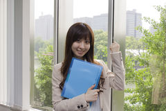 Business woman holding file in office Stock Photo