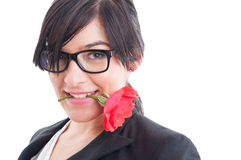 Business woman holding flower between teeth Stock Photo