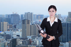 Business woman holding folder documents with city Stock Photography