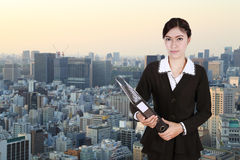Business woman holding folder documents with city Stock Images