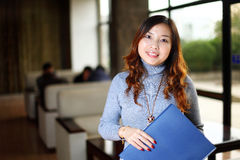 Business woman holding with folder in office Royalty Free Stock Image