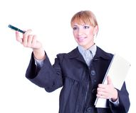 Business woman holding a folder and pen pointing Royalty Free Stock Image