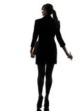 Business woman  holding folders files leaving silhouette Royalty Free Stock Photo