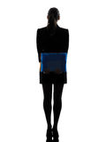 Business woman holding folders files standing  silhouette Royalty Free Stock Images