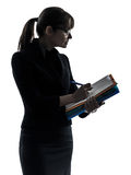Business woman  holding folders files writing silhouette Stock Image