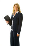 Business woman holding folio. Blonde business woman in black suit standing holding folio Royalty Free Stock Image