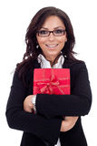 Business woman holding a gift Royalty Free Stock Images