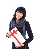 Business woman holding a gift isolated on white Royalty Free Stock Photography