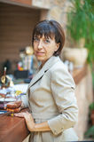Business woman holding glass of wine Stock Photography