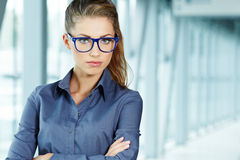 Business woman holding glasses Stock Photography