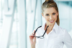 Business woman holding glasses royalty free stock images