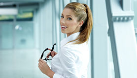 Free Business Woman Holding Glasses Royalty Free Stock Images - 26689769