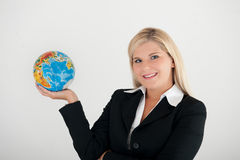 Business woman holding a globe Royalty Free Stock Image