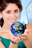 Business woman holding a globe Stock Image