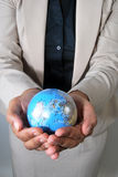 Business woman holding globe in her hands Royalty Free Stock Photo